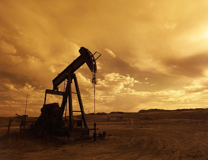 oil-pump-jack-sunset-clouds-silhouette-162568.jpg